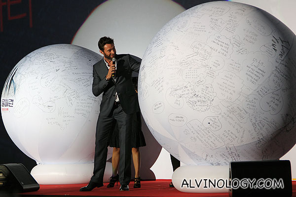 Hugh Jackman picking questions to answer from two giant balls