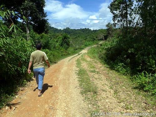 Walking/Trekking on unpaved road to New Rizal Waterfalls, Brgy. Dumarao, Roxas, Palawan