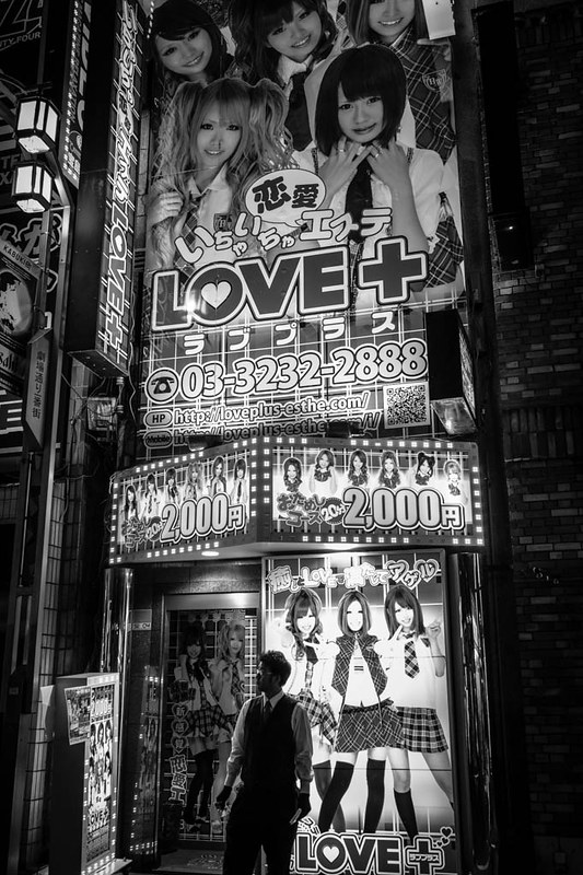Young school girls in school uniform adorn the outside of this love hotel, promising love and company.