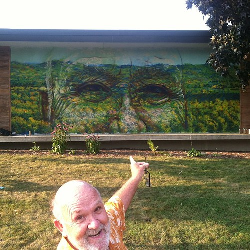 Jay in front of the first landscape portrait on the senior center. A chill conclusion to an amazing experience. Second one coming. #thesheboyganproject by gaia.streetart