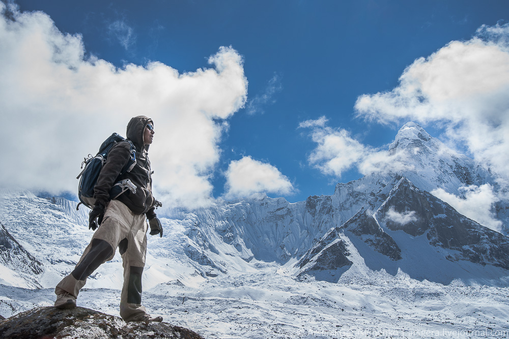 Mountaineer and Ama Damblam Peak (6812 m). Captured in Himalaya at height 4950 m