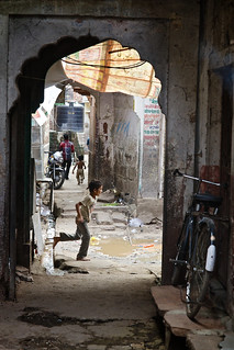 Indian child running in narrow streets, Jaipur, Rajasthan, India