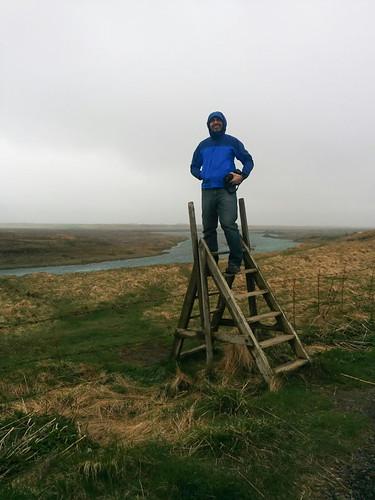 Eric climbing a fence ladder