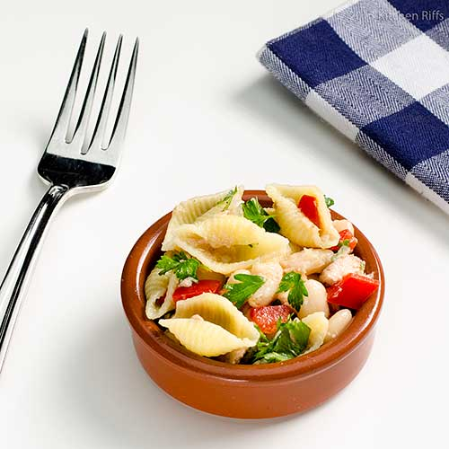 Pasta, Bean, and Tuna Salad in ramekin, with fork and napkin