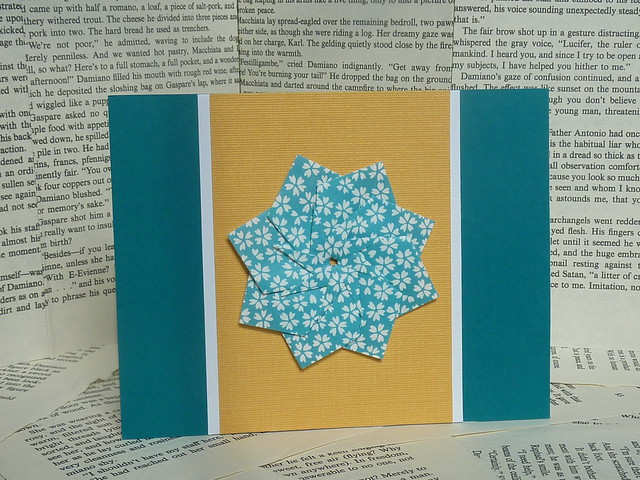 teal and yellow origami flower