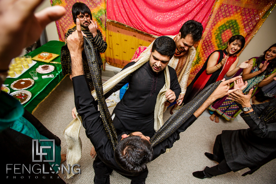 Groom and friends dancing during mehdni night