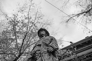 Image of Gassy Jack Statue. blackandwhite film statue vancouver clouds 50mm grey pentax cloudy gray rolandtanglaophoto gastown gassyjack