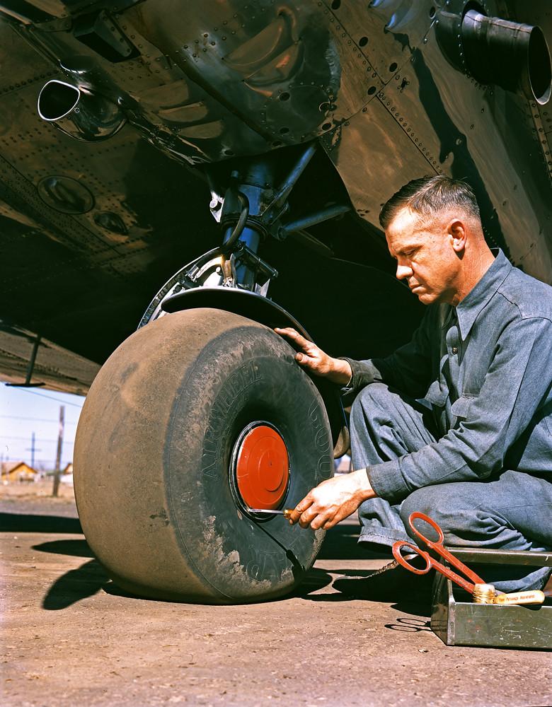 [Aviation Mechanic with Lockheed 12A Electra Junior]