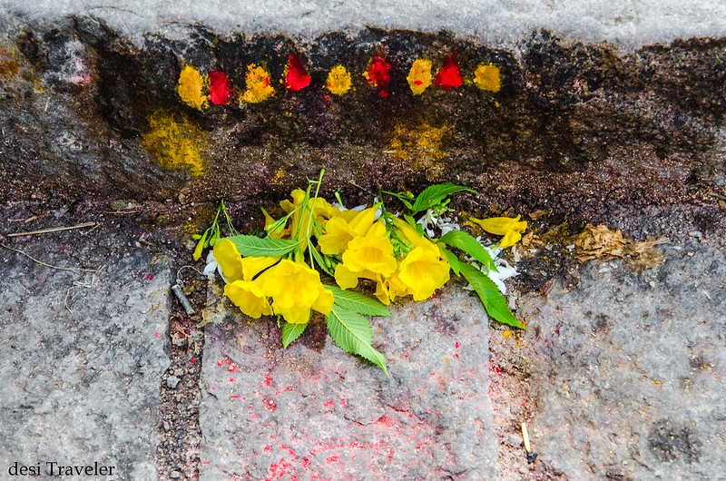 yellow flowers offered at the beginning of stairs Mahakali Temple Golconda