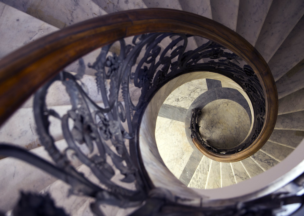 Ornate spiral stairwell leading to the library.