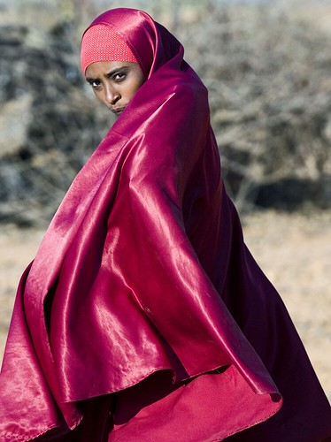 A young woman walks across the Dollo Ado refugee camp in Ethiopia