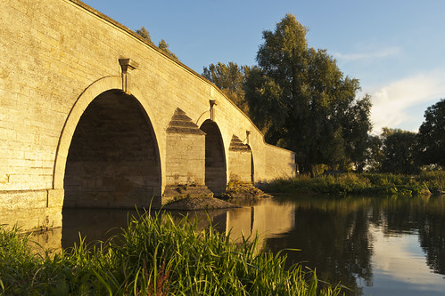 bridge sunset reflection river golden countryside scenic soe
