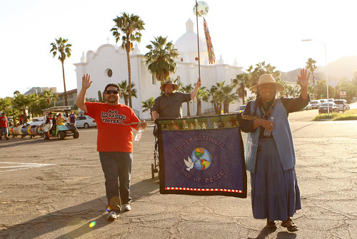 Ajo, Arizona's Sonoran Desert Retreat Center recently received an ArtPlace grant to promote small town vitality. The town's annual International Day of Peace parade brings together people from the Tohono O'odahm Nation and Sonoyta, Mexico.  Pictured here Eric Alegria (board chair of the Center), Lorraine Marquez Eiler of the Hla C-ed O'odham district on the Tohono O'odham Nation legislative Council, and (behind) Brian Mackenzie, the principal of the Ajo school. Photo courtesy of Tracy Taft.