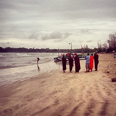 Monks on the beach. Sri Lanka
