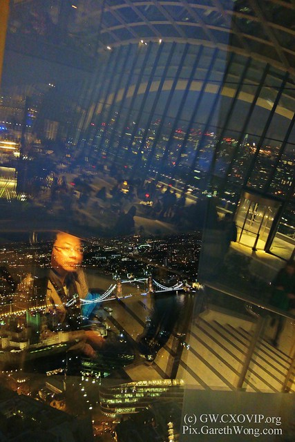 Portrait of @GarethWong with view of TowerBridge & view of Walkie talkie @SG_SkyGarden Atrium reflection at night from RAW _DSC9412