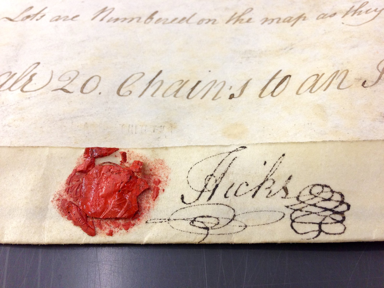 Wax seal and flourished signature