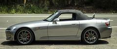 automobile(1.0), automotive exterior(1.0), wheel(1.0), vehicle(1.0), performance car(1.0), honda s2000(1.0), bumper(1.0), land vehicle(1.0), coupã©(1.0), convertible(1.0), sports car(1.0),