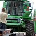 Kyle guides Oak as he loads the combine