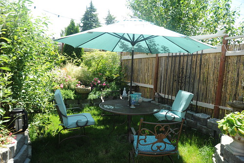 Hot summer day, patio table, umbrella and chairs, sea foam green, fencing from Pioneer's Square, bamboo fence, lotus fountain, carpet roses,A Garden for the Buddha, Seattle, Washington, USA by Wonderlane