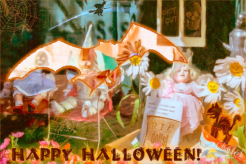 Image of a window with dolls with Halloween embellishments