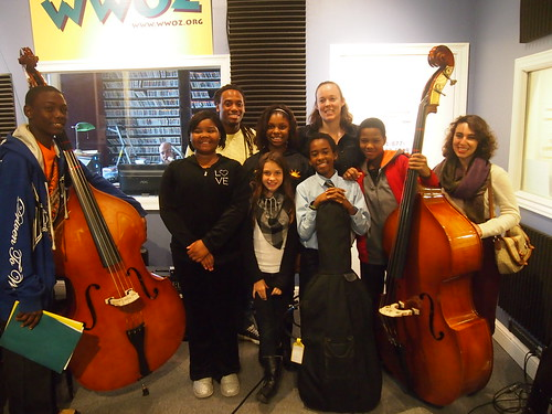 The  Ninth Ward String Orchestra: (front row) James Brown, Lori Champion, Peri Boudreaux, Tony Lamarks, Treveau Brown, chaperone (back row) Trenton Thomas, Kennedi Smith, Laura Patterson.