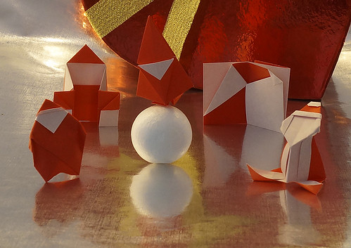 "Origami Cup Santa (Shoko Aoyagi) - Origami ""Merry Christmas!"" from Santa (Kazuko Shirai) - Origami Santa Claus (Noriko Nagata) - Origami Pureland Santa Card (Sy Chen) - Origami Jolly Santa (Marcia Joy Miller)"