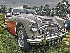 aston martin db2(0.0), aston martin db6(0.0), automobile(1.0), vehicle(1.0), automotive design(1.0), austin-healey 100(1.0), austin-healey 3000(1.0), antique car(1.0), classic car(1.0), vintage car(1.0), land vehicle(1.0), coupã©(1.0), convertible(1.0), sports car(1.0),