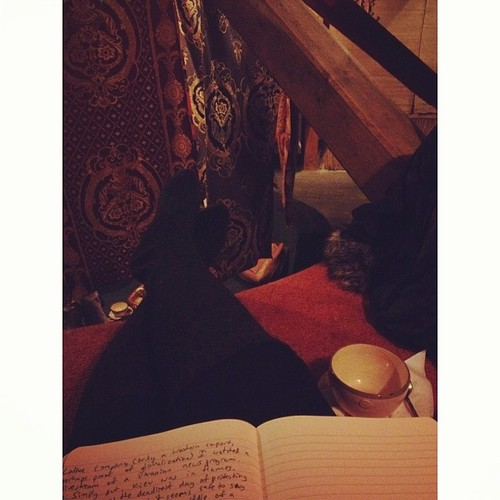 Relaxing with a teacup and journal.