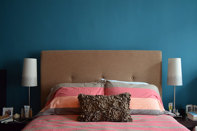 Berlin apartment_dark walls, West Elm pink bedding and headboard