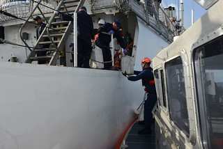 Coast Guard crewmembers aboard the Coast Guard Cutter Spencer transfer bales of cocaine to a boatcrew from Coast Guard Base Miami Beach, Florida, off the coast of Miami May 10, 2014. During a patrol, the crew aboard the Spencer interdicted 1,327 pounds of cocaine off the coast of the Dominican Republic on April 21, 2014. U.S. Coast Guard photo by Petty Officer 3rd Class Mark Barney.