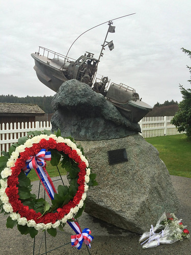 "A memorial wreath with a the words ""Gone But Never Forgotten"" stands in front of the permanent memorial honoring three crew members from Coast Guard Station Quillayute River who lost their lives during a rescue mission 18 years ago, in La Push, Wash.  (U.S. Coast Guard photo by Master Chief Petty Officer Charles Lindsey)"