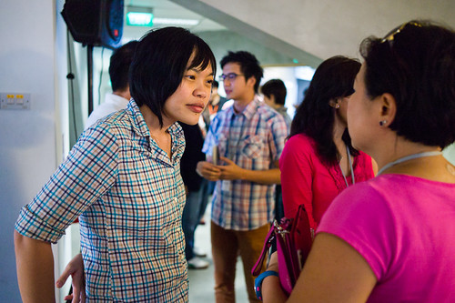 Shiao-Yin, left, listening to a UCP participant during the networking session