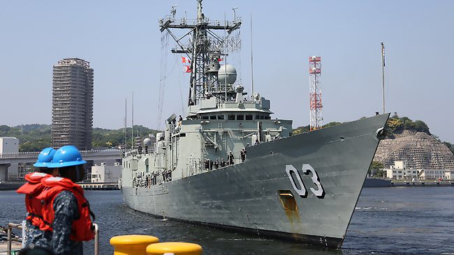 HMAS Sydney arrives at the naval base in Yokosuka south of Tokyo yesterday to start a three-month tour with the US fleet.