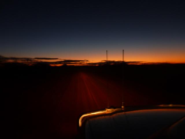 Sunsert desert road driving