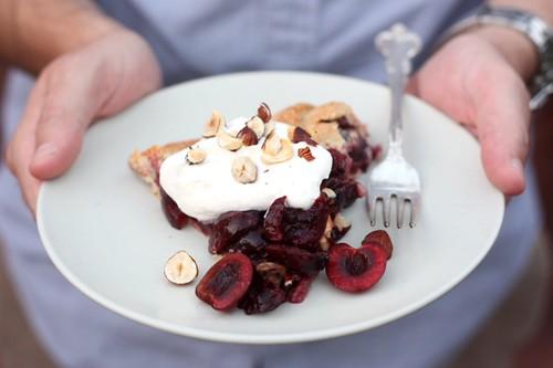 Sweet cherries nestled inside a crust made from hazelnut flour. Serve ...