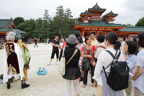 Cosplayers surrounded by tourists at Heian Shrine