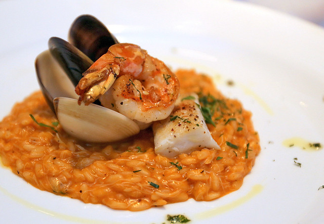RISOTTO ALLO SCOGLIO: Sea Rock Style Risotto with Langoustine, Crab, Mussels, Clams, Tomato and Parsley