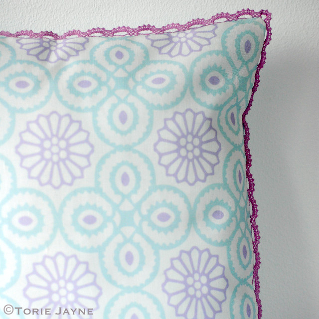 Crochet trimmed cushion