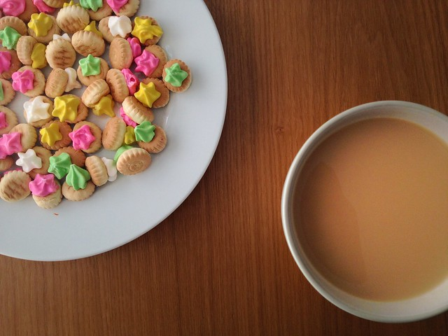 iced gem biscuits with a cup of milky tea