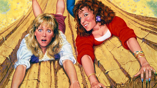Shelley Long and Bette Midler hang precariously off a cliff in the poster for Outrageous Fortune