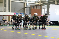 roller hockey(0.0), roller in-line hockey(0.0), skating(1.0), roller sport(1.0), sports(1.0), competition event(1.0), roller derby(1.0), roller skating(1.0),