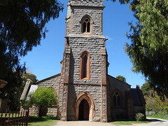 Braidwood. St Andrews Anglican Church in Braidwood made of the local granite. Fine tower. Church built in 1881 and designed by Edmund Blacket. Tower added in 1900 with gargoyles