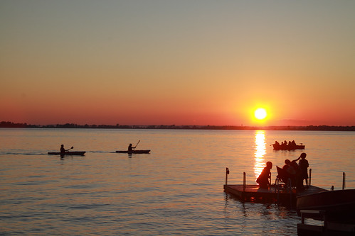 sunset summer sun sunlight reflection water silhouette kayak westlake sandbanks kayaks shorefront