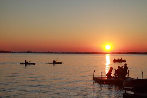 sunset summer sun sunlight reflection water silhouette kayak westlake sandbanks kayaks shorefront