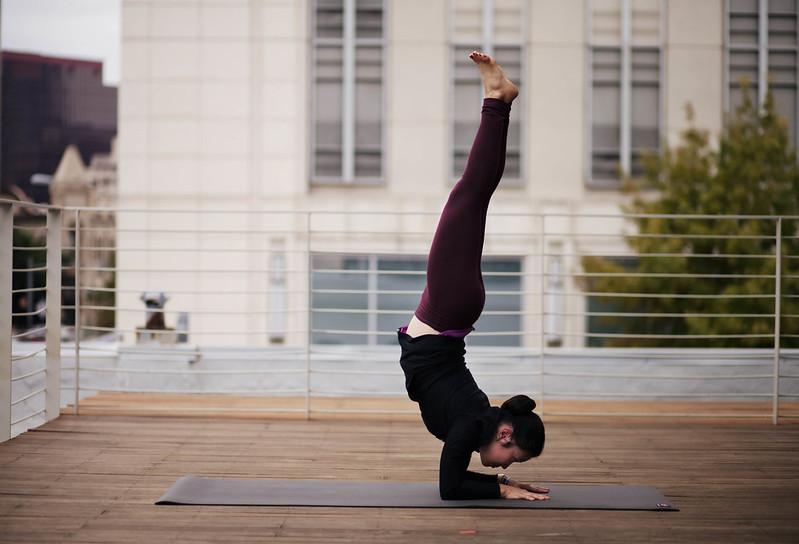 cute & little blog | wanderlust austin yoga festival | yoga forearm balance Pincha Mayurasana pose