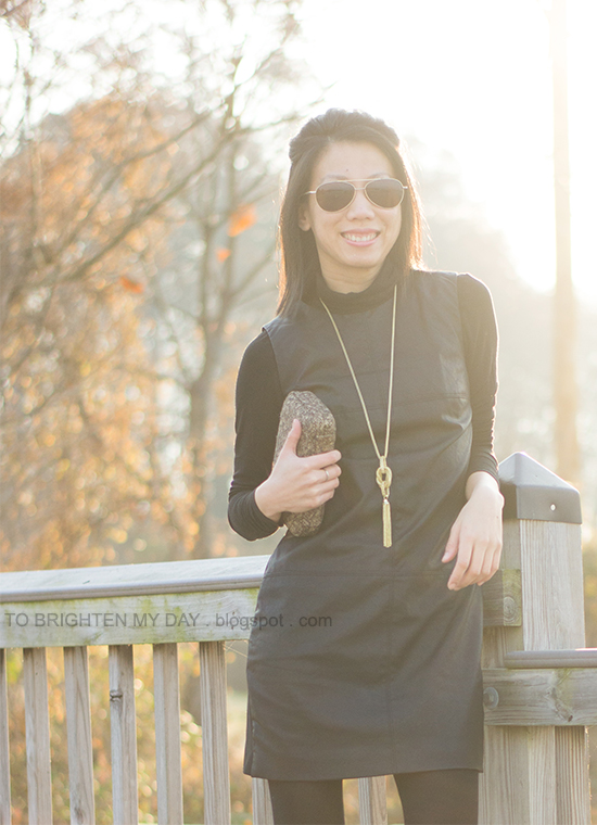 faux leather dress, black turtleneck, tassel necklace