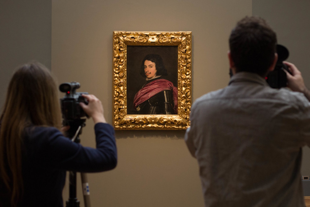 Photographers take pictures of a portrait of Duke Francesco I d'Este by Diego Velázquez at the Met in New York.