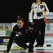 New Brunswick skip Rene Comeau reacts as Manitoba skip Braden Calvert looks on during the men's final.