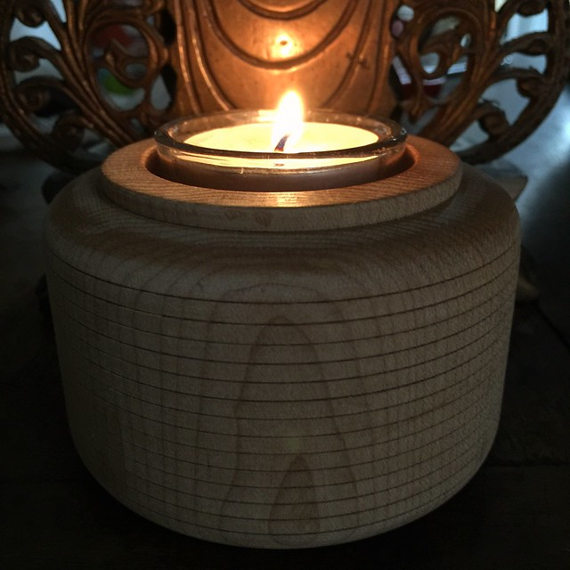 A votive candle holder I made out of maple.