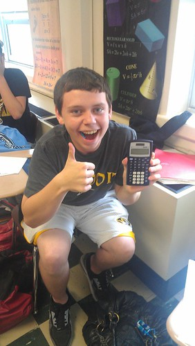 grinning boy with calculator